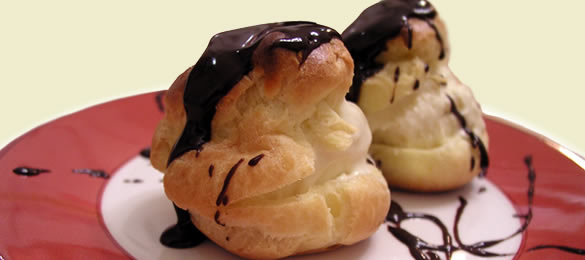 Profiteroles with Ice Cream and Chocolate Sauce